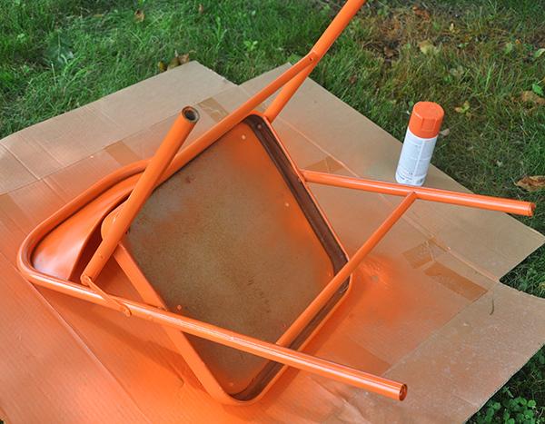 spray painted metal folding chair